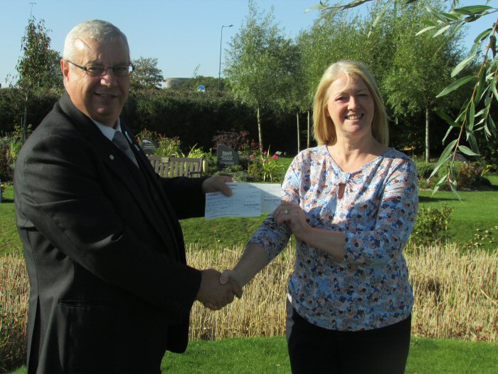 Chapel Attendant Ray Lawton, presenting the cheque to to Victoria Rogers from Zoe's Place